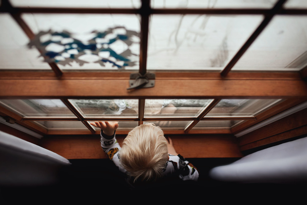 pic-of-boy-looking-out-a-window-by-meg-loeks